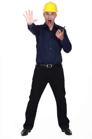 two way: Architect with radio making stop gesture with hand Stock Photo