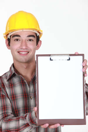 high spirited: Young construction worker holding up a blank clipboard Stock Photo