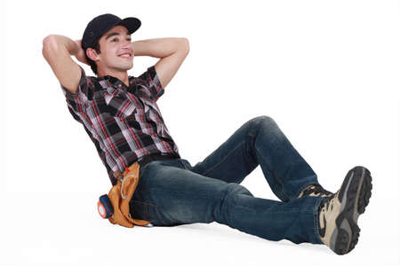 A young construction worker resting Stock Photo - 15263628