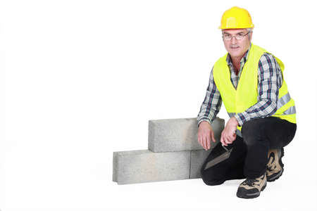 kneeled: A kneeled mature mason  Stock Photo