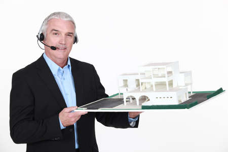 Architect holding replica of housing project photo