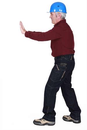Senior laborer on white background Stock Photo - 15263461
