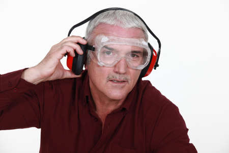 Man in safety goggles and ear defenders Stock Photo - 15263731