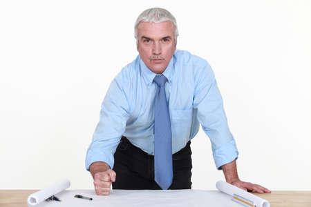 banging: senior architect banging his fist on the table Stock Photo