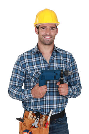 power drill: Builder with a power drill
