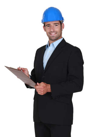 engineering clipboard: portrait of happy foreman and clipboard Stock Photo