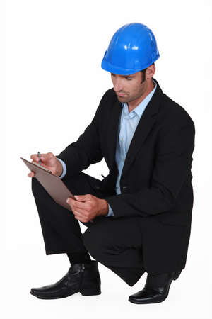 engineering clipboard: Handsome engineer with a clipboard