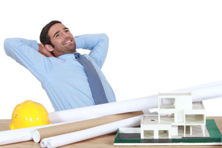 architect office: Architect stretching at his desk