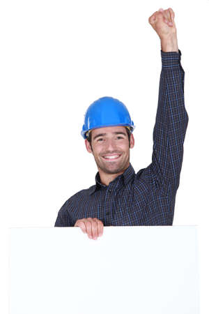 Happy laborer with fist up in the air Stock Photo - 15263528