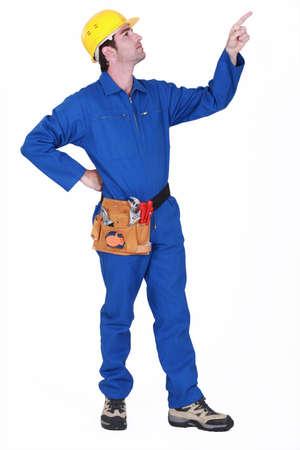 Pointing upwards workman Stock Photo - 15263565