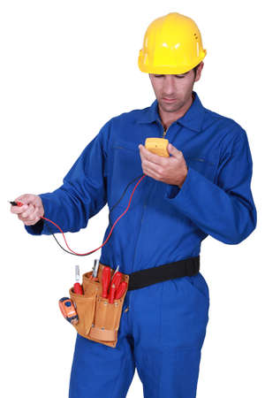 ampere: electrician with tester