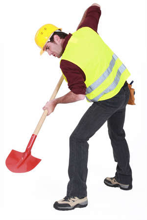 workman: A male construction worker digging