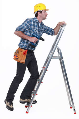 A handyman climbing a ladder  photo