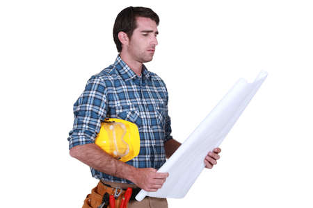 preoccupied: Foreman looking pre-occupied Stock Photo