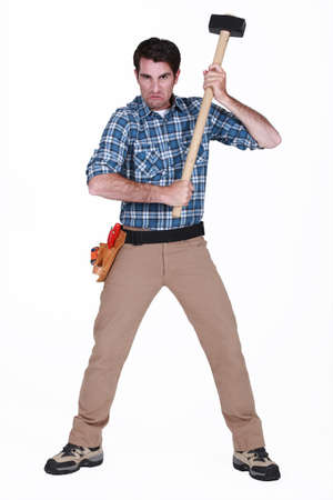 frenetic: furious craftsman holding a hammer Stock Photo