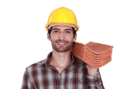 rooftiles: craftsman holding roof tiles Stock Photo