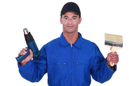 screw jack: Tradesman holding a paintbrush and a screw gun
