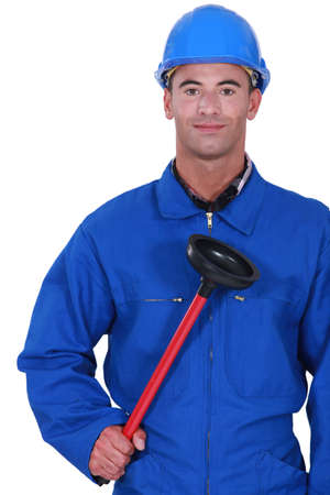 clearing: Plumber holding a plunger Stock Photo