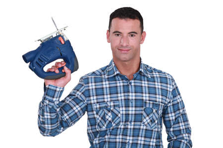 sander: carpenter holding sander machine