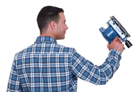 Man using powered sander photo