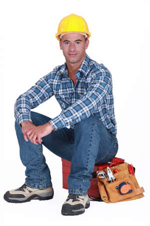 A construction worker sitting on his toolbox  photo