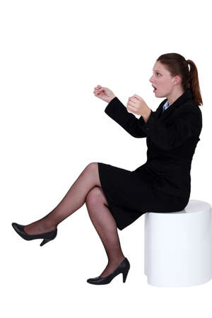 A businesswoman gripping an invisible object Stock Photo - 15263414
