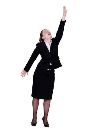 people looking up: Businesswoman reaching up