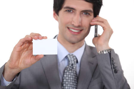 businessman showing business card photo