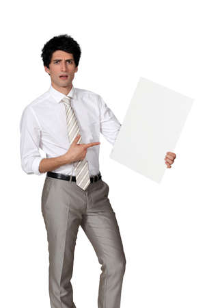 Elegant man pointing a blank square Stock Photo - 15263627