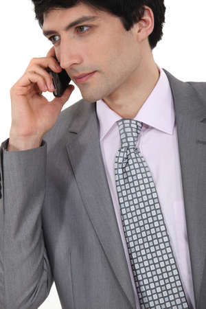 Portrait of successful businessman making telephone call Stock Photo - 15263872