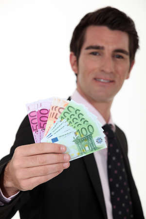 Businessman with a wad of cash photo