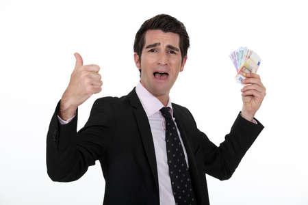 ego: Rich businessman rejoicing