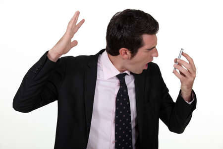 Businessman screaming down the phone Stock Photo - 15263744