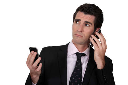 available time: Man with two phones