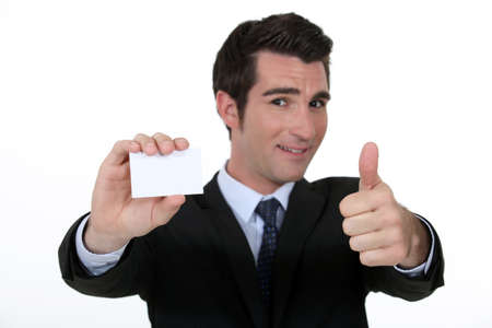 Thumbs up form n executive with blank business card Stock Photo - 15263470