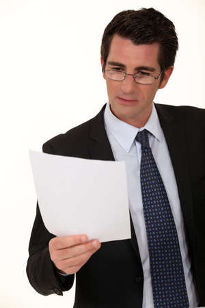 assimilate: Businessman reading a document Stock Photo