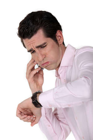 tardy: businessman under pressure consulting his watch Stock Photo