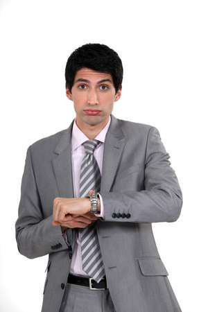 Businessman realizing he is late Stock Photo - 15263820