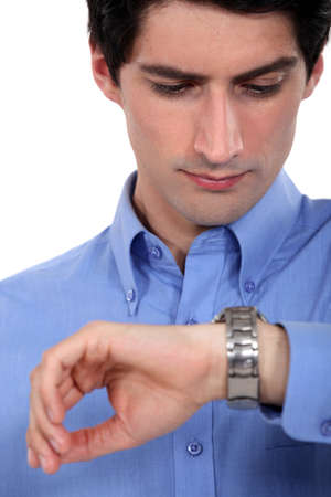 looking at watch: Businessman looking at his watch