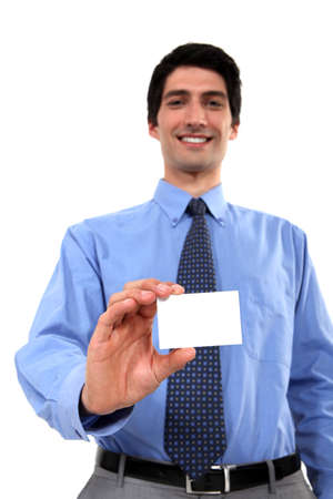 Executive holding a blank business card Stock Photo - 15263544