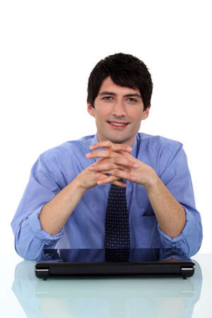 Relaxed man sitting at a desk photo