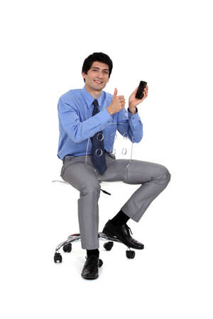 businessman very satisfied with his cell Stock Photo - 15263427