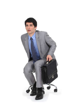 perceptive: Businessman leaving to catch a taxi Stock Photo