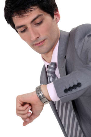 Businessman checking the time photo
