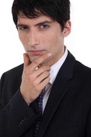 Businessman with his hand on his chin photo