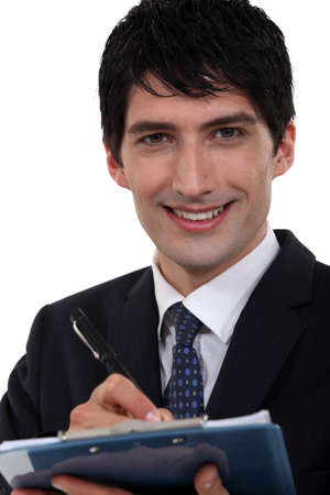 polls: Smiling executive with a clipboard Stock Photo