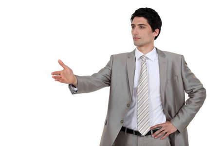 self help: Confident businessman offering to shake hands