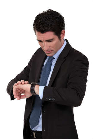 Businessman checking his watch Stock Photo - 15263632