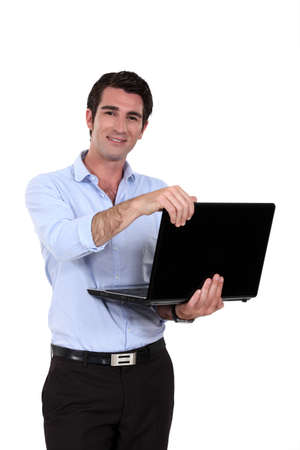 A businessman standing with his laptop  photo