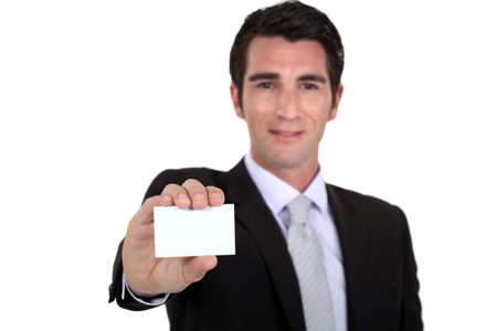 Confident businessman flaunting business card photo